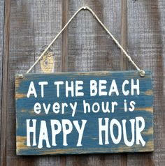 "Beach Decor, Beach Theme, Beach Wood Sign, ""At The Beach Every Hour Is Happy Hour"" from Signs Of Love - Carova Beach. Saved to Signs. Beach Wood Signs, Beachy Signs, Beach Quotes, Ocean Quotes, I Love The Beach, Beach Bars, Am Meer, Beach Crafts, Do It Yourself Home"