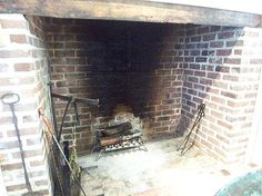 Rumford-style large hearth cooking fireplace in kitchen