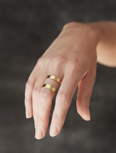 DOUBLE BAND BRASS RING Young Frankk launched in 2012 by, artist turned jewelry designer, Christine Young. As a graduate of Parsons School of Design for Illustration, she incorporates her drawing experience into her designs by translating line work onto metal. Every piece is made by hand by the designer, creating one-of-a-kind and unique pieces in her studio in Richmond, Virginia.  / size: adjustable & .75 tall / sealed brass $65.00
