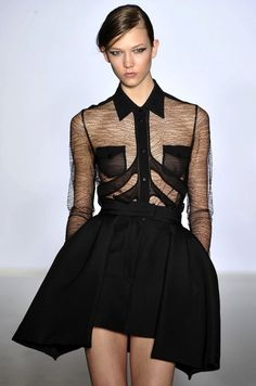 Structured skater skirt combined with a black sheer top. Such an elegant combination.