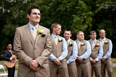 Blue shirt under tan vest for groomsmen.  but with grey vests?! :)