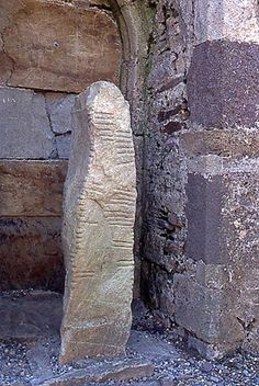 Ogham stone located within a 12th century church at Ardmore Co Waterford.