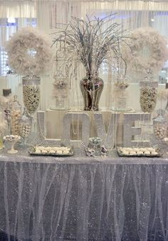 With wedding season just around the corner, this all white and silver, diamond and pearl filled candy bar would be a fabulous set-up at a...