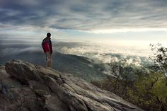 Safety on the Appalachian Trail. A man stands on rocks overlooking the mountains in the distance