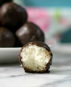 Coconut Clusters - A healthy, low calorie truffle, chock full of coconut and sweetened with a pinch of powdered sugar and rolled in luscious, rich, dark chocolate.
