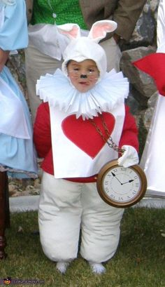 I like this costume for the rabbit because it doesn't just show that it's just a regular rabbit. The rabbit always carries the clock, and with that heart card, it helps to show that it's the rabbit from Alice in Wonderland.