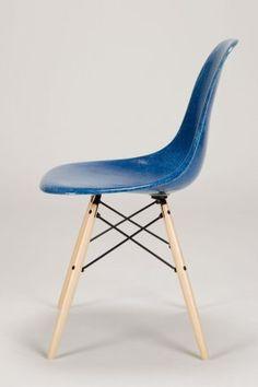 A Set of 6 Ocean Blue Dowel Base Eames Chairs