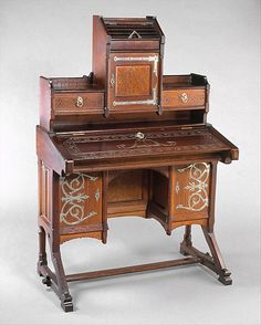 Desk  Kimbel and Cabus  (1862–1882)  Date: ca.1877 Geography: Mid-Atlantic, New York City, New York, United States Culture: American Medium: Oak, nickel-plated brass and iron hardware