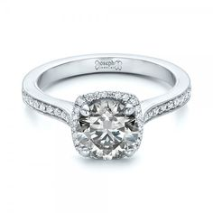 #102097 This stunning engagement ring features a fancy grey diamond solitaire surrounded by a halo of split prong set diamonds. It was created as a custom piece for a client...