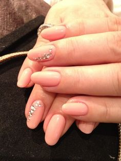 Rounded perfectly pink nails with crystal arcs from R DECO Nail Salon in Osaka