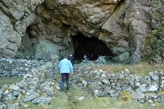 I believe this is the biggest cave on Islay, the big cave at Bholsa in the north of Islay. The people looking around the entrance give an idea how big it is. Cave Entrance, Isle Of Islay, House Layouts, Highlands, Cliff, Pixel Art, Britain, Walking, Island