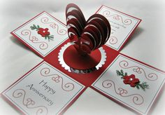 This Exploding Box style 25th Anniversary card opens to reveal 3 dimensional silver and red hearts as a centerpiece. The exploding side panels