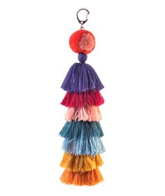 For the funky friend or fashionista that seems to have it all, this soft charm is a great addition to any accessory collection (no matter how large or small it already is). Have her attach this plush piece to her favorite everyday tote or bucket bag—at 12 inches long it's sure to stand out and make a statement.