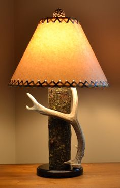 A maple log and whitetail deer antler for this lamp.