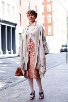 Lovely combo of classic '50s styling and a giant Grandma sweater