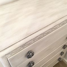 Close up of vintage drawers painted with Annie Sloan old white with lots of Autentico's sparkling silver wax rubbed in to age the paint