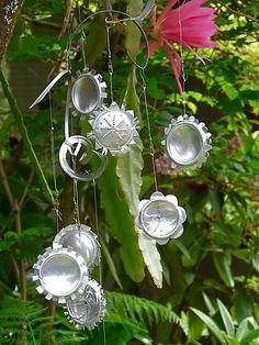 Midsummer Sun Mobile from Recycled pop cans: technique here: http://gingerbreadsnowflakes.com/node/196