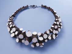 Wood and paint necklace by Terhi Tolvanen