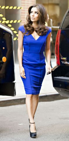 Eva Longoria in a short sleeve blue knee length pencil dress
