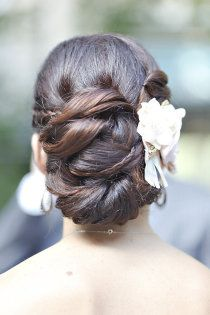 LOVE the little hidden braid entwined with the bun