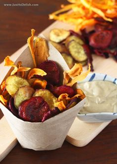 Baked Vegetable Chips are very easily made in your very own oven. Peel, slice, and bake. Eat. Enjoy with a tangy tahini dip.