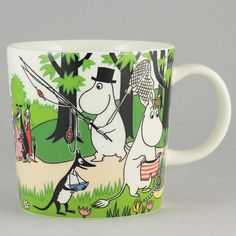 "Arabia's mug ""Going on vacation"" (Lähdetään lomalle) with elegant shape and kind motif from the Moomin world. Charming pottery from Finland."