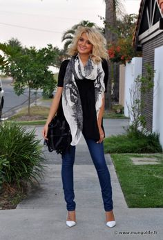 Love the white shoes with the black shirt and scarf