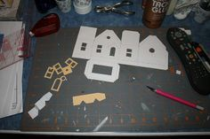 How to make a putz house....all pattern pieces are cut by christmasnotebook, via Flickr