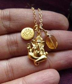 Items similar to Ganesh. gold plated Ganesh pendant with lotus charm and hessonite garnet on Etsy 1 Gram Gold Jewellery, Gold Jewellery Design, Gold Jewelry, Garnet Jewelry, Gold Earrings Designs, Necklace Designs, Gold Pendants For Men, Ganesh Pendant, Gold Pendent