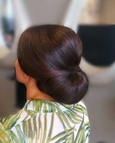 Elegant chignon bun by Doni
