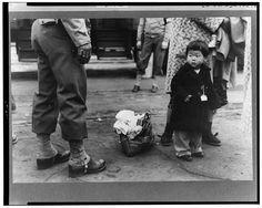 Child waiting to be sent to internment camp, 1942