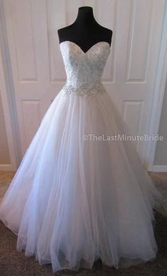 Madison James MJ217 wedding dress currently for sale at 46% off retail.