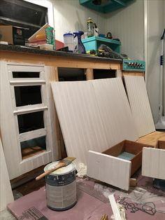 Cabinet doors being painted.