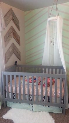 Baby girl nursery room. Blush pink, mint green, navy blue, and gold. Rustic shabby chic and modern.