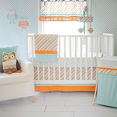 Soft aqua and warm orange come together in the cheery and modern Penny Lane Crib Bedding Collection by My Baby Sam.