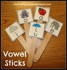 DIY vowel sticks. Free downloadable pics to make your own.