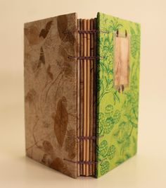 "'Passion': 3 3/4 x 5 3/4 x 1"" (Spine) Coptic Stitch, 6 wrapped signatures made with 100% Recycled Classic Laid Text paper, wrapped signatures include ecoprint, handmade leaf and vintage book papers, $55, made by Becca Imbur of Bimbur Books #riverspirit #handmadebooks #vintagebooks #green #paradise #botanical #ecoprint #ecoprinting #handmadepaper #nature #journal #journaling #notebook #sketchbook #leaf"