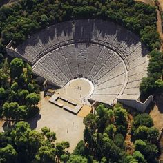 Ancient Theater of Epidaurus, Peloponnese, Greece  It was designed by Polykleitos the Younger in the 4th century BC.   The theatre is admired for its exceptional acoustics. 14,000 seater.