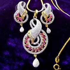 Ruby American Diamond Gold Plated Chain Pendant Earring Set Beautifully hand crafted Pendant and Earrings Sparkles like real diamond gold necklace High quality American Diamonds are used Gold plated pendant set   ₹1,125.00 INR buy at http://crazyberry.in/online-shopping/artificial-imitation-fashion-jewellery/ruby-american-diamond-gold-plated-chain-pendant-earring-set