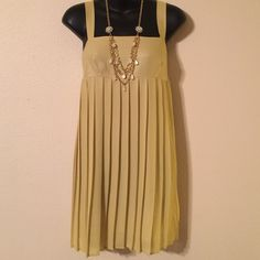 Dress Glam dress!!!! This yellow pleated dress is light weight and hides all flaws! With the right accessories you can wear this dress year round! Glam Dresses