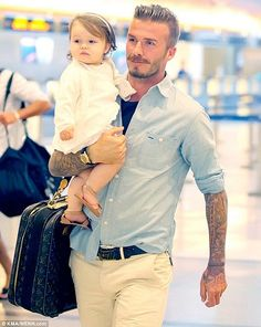 {David & little Harper Seven Beckham} by {this is glamorous}