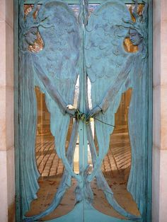 Two angels guide you through these entrance doors and their wings and hands meet you in the middle!