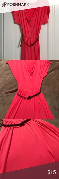 TART Collections Lightweight dress This is such a cute spring dress! Ruched top, cinched at waist, somewhat flowy bottom. Has a wrap look to the bottom but is not a wrap at all (material is continuous all the way around). Tiny stain near flap of dress (see pic). Barely noticeable. Comes with belt. Color is a coral/pink. Tart Dresses