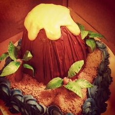 Luau volcano cake! With a special lava center...inspired by I Am Baker's surprise cakes. :)  Sweet Biscuit Bakery: Luau!