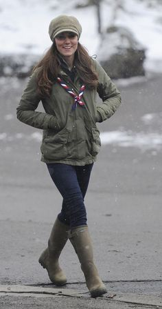 Kate donned practical wellies and an army jacket for a trip to the Great Tower Scout camp at Newby Bridge in Cumbria on March 22. You've gotta hand it to a woman who volunteers to help build fires and set up campgrounds—in the pouring rain, no less—while pregnant!