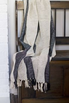 Stripes Kikoy Throw. At the end of the year Red Earth Trading Company's profits are given to sustain the community development work of Know Think Act. #GiveBack