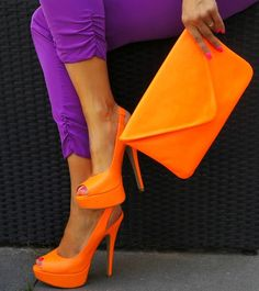 purple skinnies, orange shoes and bag