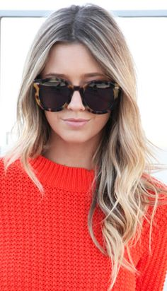 Bright knit sweater + tousled hair + oversized tortoise sunnies
