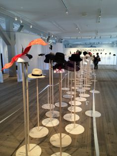 Hats at Copenhagen Exhibit.  Sorry not to have additional info/details. Other than it appears to have been a show in June of 2014 to coincide with Fashion Week.  Like how the details are on the base of the stands.  A link to the exhibit (no pics) - http://www.rundetaarn.dk/en/a-thousand-and-one-hats/
