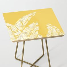 Banana Leaves On Yellow Side Table by Designdn - Gold - Square Painted Side Tables, Painted Coffee Tables, Counter Stools, Bar Stools, Yellow Side Table, Stencil Graffiti, Banana Leaves, Modern Table, Dorm Decorations